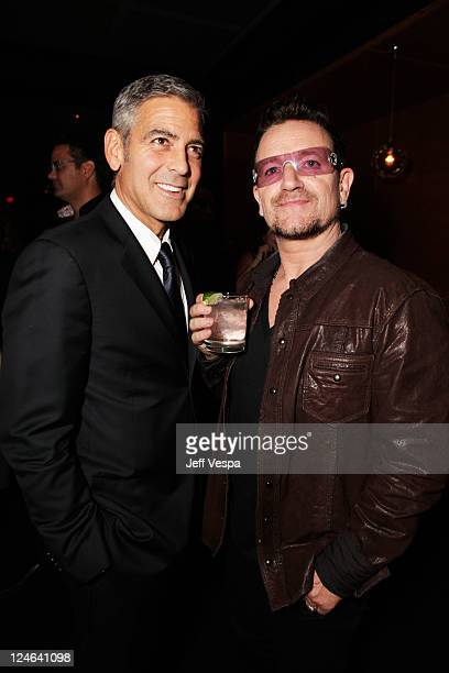 Actor George Clooney and Singer Bono of U2 attend the Fox Searchlight Pictures Belvedere Vodka And Vanity Fair Celebration of Martha Marcy May...