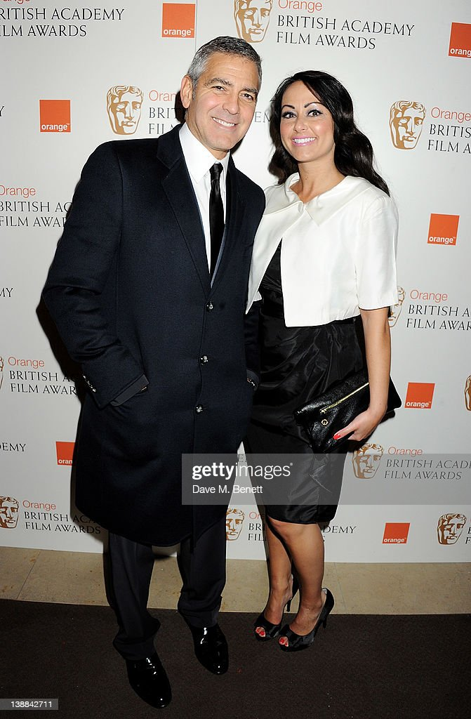 Actor George Clooney (L) and Sonja Stephen arrive at the Orange British Academy Film Awards 2012 at The Royal Opera House on February 12, 2012 in London, England.