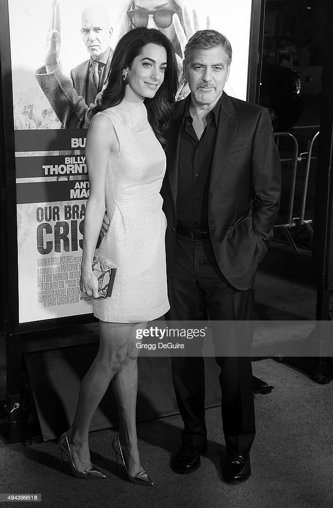 Actor George Clooney and wife Amal Clooney arrive at the premiere of Warner Bros. Pictures' 'Our Brand Is Crisis' at TCL Chinese Theatre on October 26, 2015 in Hollywood, California.