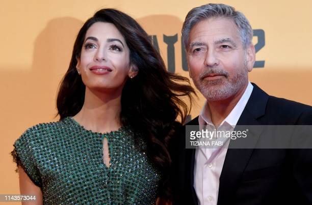 US actor George Clooney and wife BritishLebanese Amal Clooney arrive to the premiere of Catch22 on May 13 2019 in Rome