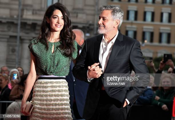 TOPSHOT US actor George Clooney and wife BritishLebanese Amal Clooney arrive to the premiere of Catch22 on May 13 2019 in Rome