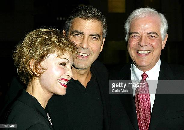 Actor George Clooney arrives with parents Nina and Nick Clooney for the world premiere of the film 'Intolerable Cruelty' September 30 2003 in Beverly...