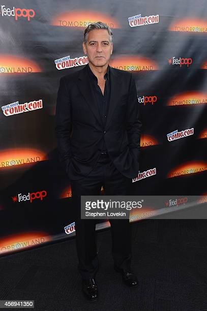 Actor George Clooney attends Walt Disney Studios' 2014 New York Comic Con presentations of Big Hero 6 and Tomorrowland at the Javits Convention...