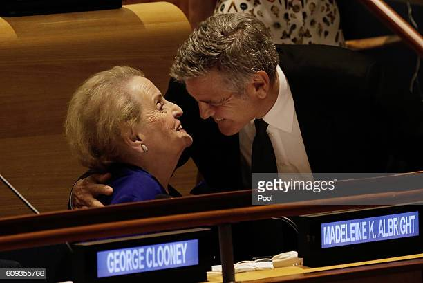 Actor George Clooney embraces former US Secretary of State Madeleine Albright at a Leaders Summit for Refugees during the United Nations 71st session...