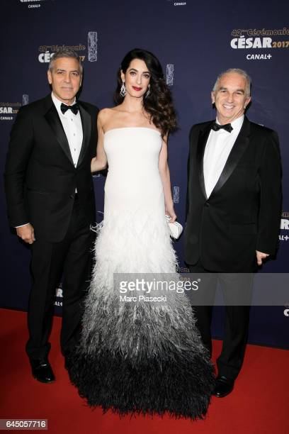 Actor George Clooney his wife Amal Clooney and Alain Terzian attend the 'CESARS Film Awards 2017' ceremony at Salle Pleyel on February 24 2017 in...