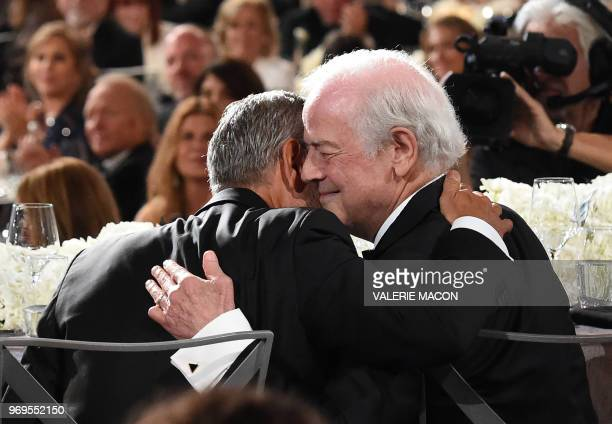 US actor George Clooney hugs his father Nick Clooney at the 46th American Film Institute Life Achievement Award Gala at the Dolby Theatre in...