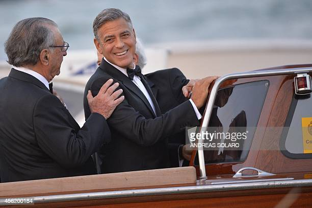 US actor George Clooney is pictured with his father in law Ramzi Alamuddin on a taxi boat after he leaves the Cipriani hotel on September 27 2014 in...