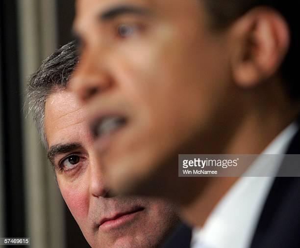 Actor George Clooney listens as Sen. Barack Obama speaks at The National Press Club Newsmaker's Program April 27, 2006 in Washington, DC. Clooney...