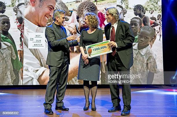 US actor George Clooney managing director of Nationale Postcode Loterij Marieke van Schaik and John Prendergast are pictured during the Goed Geld...