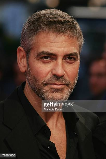 Actor George Clooney poses as he arrives to attend the premiere of Michael Clayton during the 33rd Deauville American Film Festival, on September 2,...