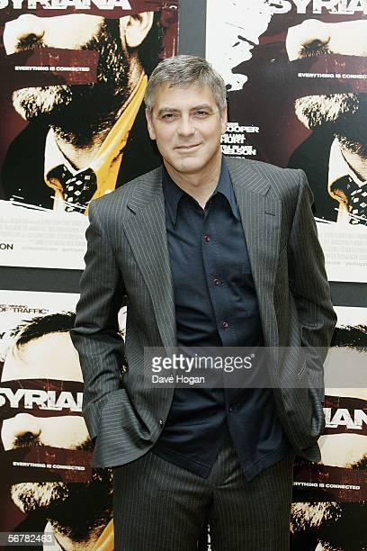 Actor George Clooney poses at a photocall to promote Stephen Gaghan's new film Syriana based on CIA agent Robert Baer's memoirs at The Dorchester on...