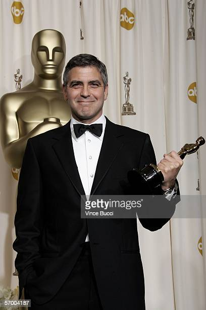 BROADCAST*** Actor George Clooney poses with his Oscar statuette for Best Actor in a Supporting Role for Syriana during the 78th Annual Academy...
