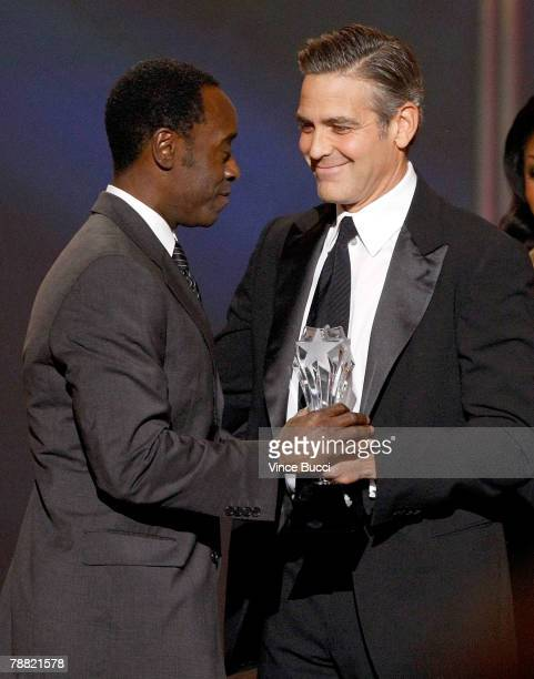 Actor George Clooney presents the Joel Siegel Award to Don Cheadle onstage during the 13th annual Critics' Choice Awards held at the Santa Monica...