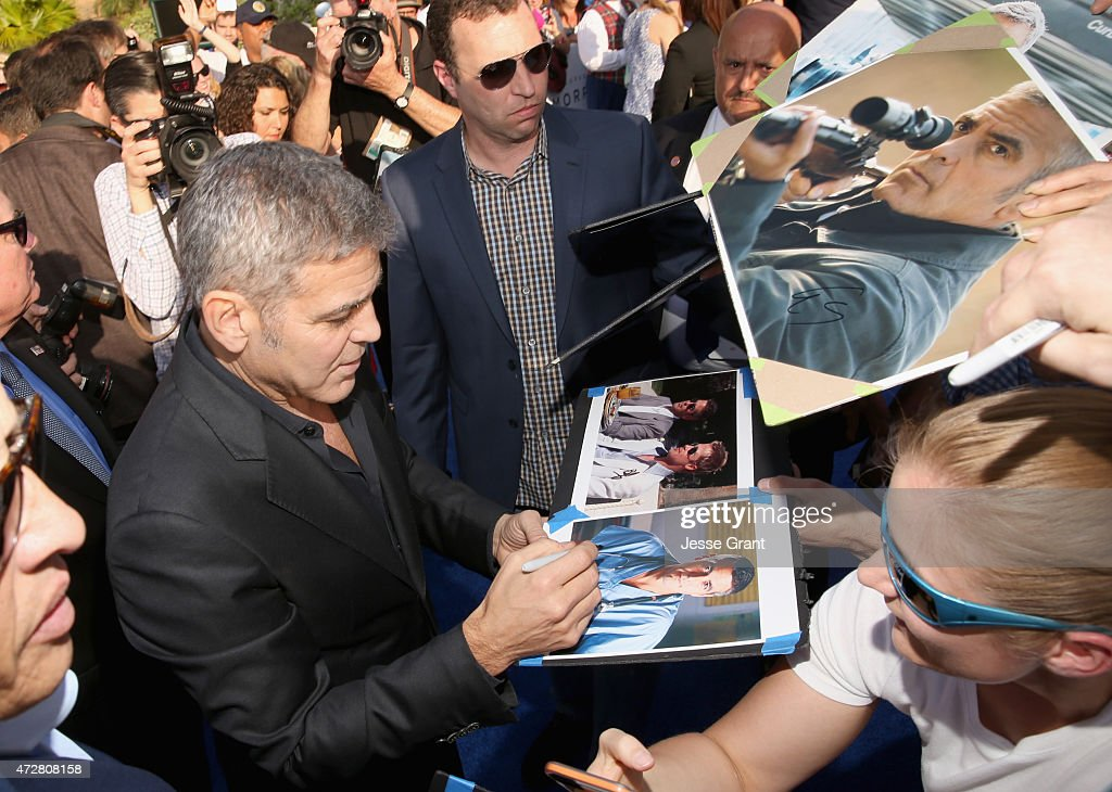 Actor George Clooney signs autographs at the world premiere of Disney's 'Tomorrowland' at Disneyland, Anaheim on May 9, 2015 in Anaheim, California.