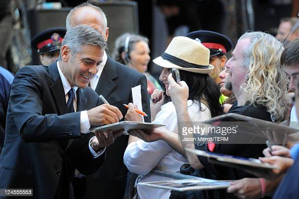 "Actor George Clooney signs autographs for fans at ""The Descendents"" Premiere at The Elgin during the 2011 Toronto International Film Festival on..."