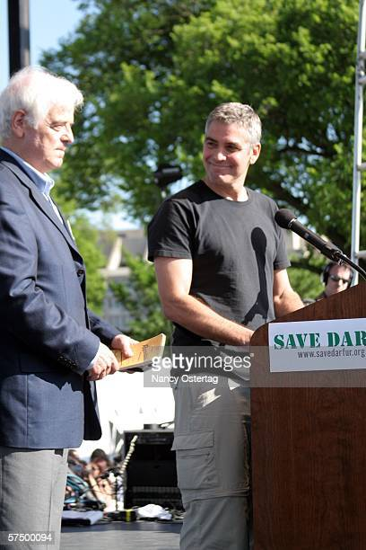 Actor George Clooney speaks with his father Nick Clooney during Save Darfur Rally To Stop Genocide April 30 2006 in Washington DC