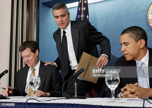 Actor George Clooney takes his seat at The National Press Club Newsmaker's Program April 27, 2006 in Washington, DC. Clooney joined Sen. Sam...