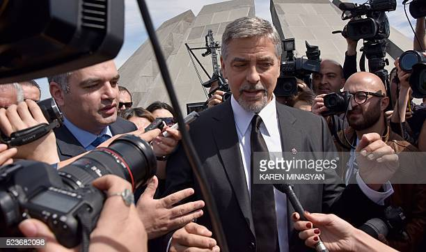 Actor George Clooney talks to media in Yerevan at the Genocide Memorial on April 24, 2016. Hollywood star and rights advocate George Clooney led...