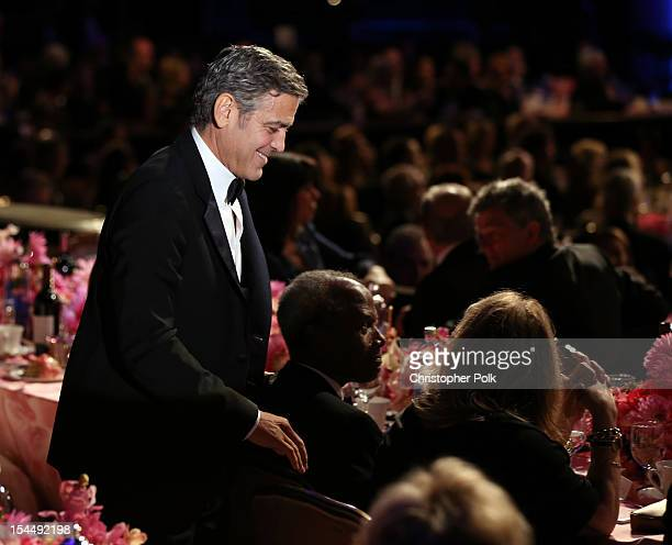 Actor George Clooney walks onstage during the 26th Anniversary Carousel Of Hope Ball presented by MercedesBenz at The Beverly Hilton Hotel on October...