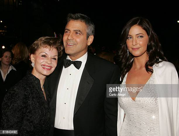 Actor George Clooney with model Lisa Snowdon and mother Nina Warren arrive to the Warner Bros premiere of the film Ocean's Twelve at Grauman's...