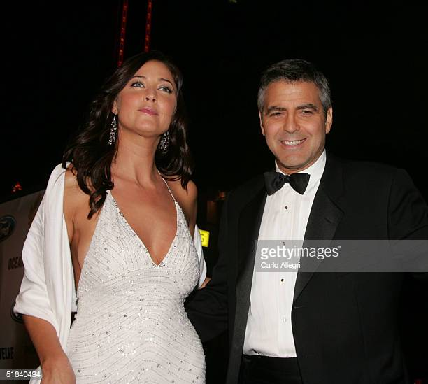 Actor George Clooney with model Lisa Snowdon arrive to the Warner Bros premiere of the film Ocean's Twelve at Grauman's Chinese Theatre December 8...