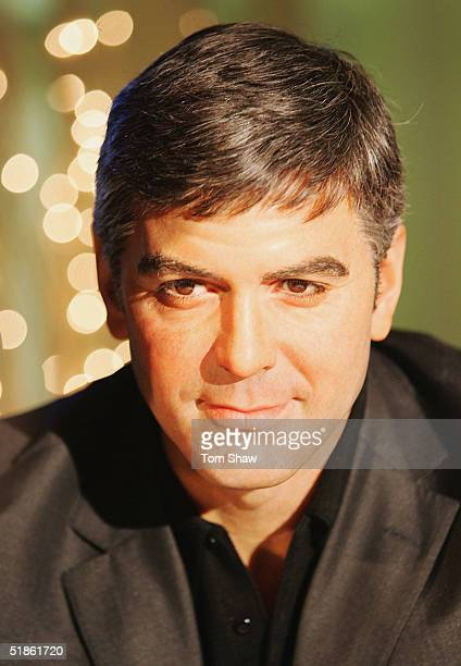 Actor George Clooney's waxwork model is unveiled at Madame Tussauds on December 15 2004 in London England The newest addition to the waxwork museum...