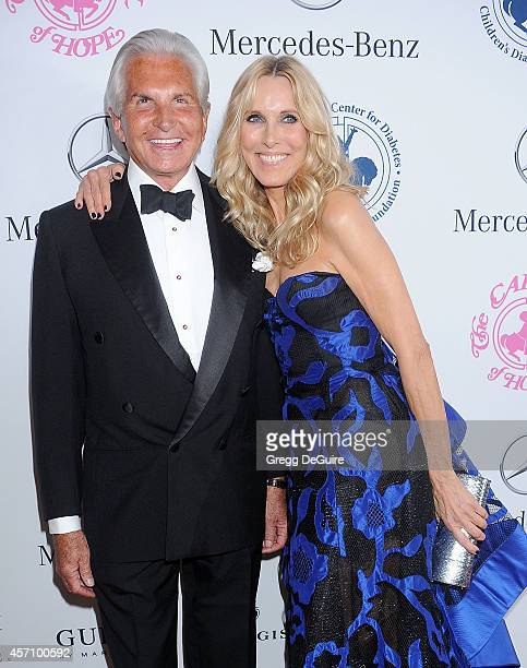 Actor George Hamilton and Alana Stewart arrive at the 2014 Carousel Of Hope Ball Presented By MercedesBenz at The Beverly Hilton Hotel on October 11...