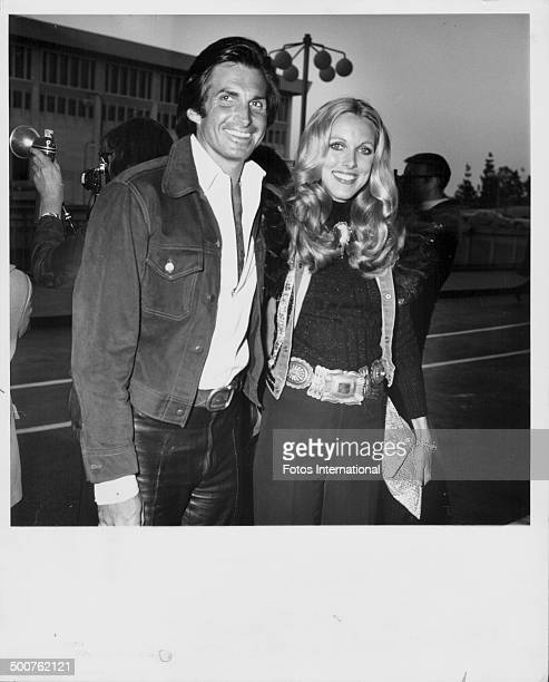 Actor George Hamilton and his wife Alana Collins attending the James Stacy Charity Dinner in Hollywood California March 1974