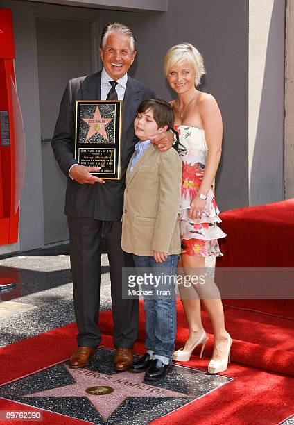 Actor George Hamilton with girlfriend Barbara Sturm and his son George Thomas Hamilton attend the ceremony honoring the actor with a star on the...
