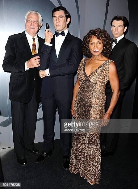 Actor George Lazenby and actress Gloria Hendry attend the unveiling of all six James Bond wax figures at Madame Tussauds on December 15 2015 in...