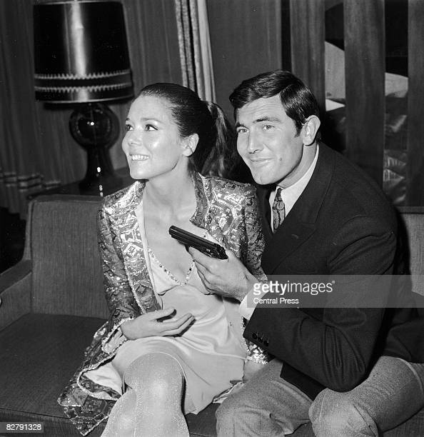 Actor George Lazenby with actress Diana Rigg during a press conference for the James Bond film 'On Her Majesty's Secret Service' in London, 14th...