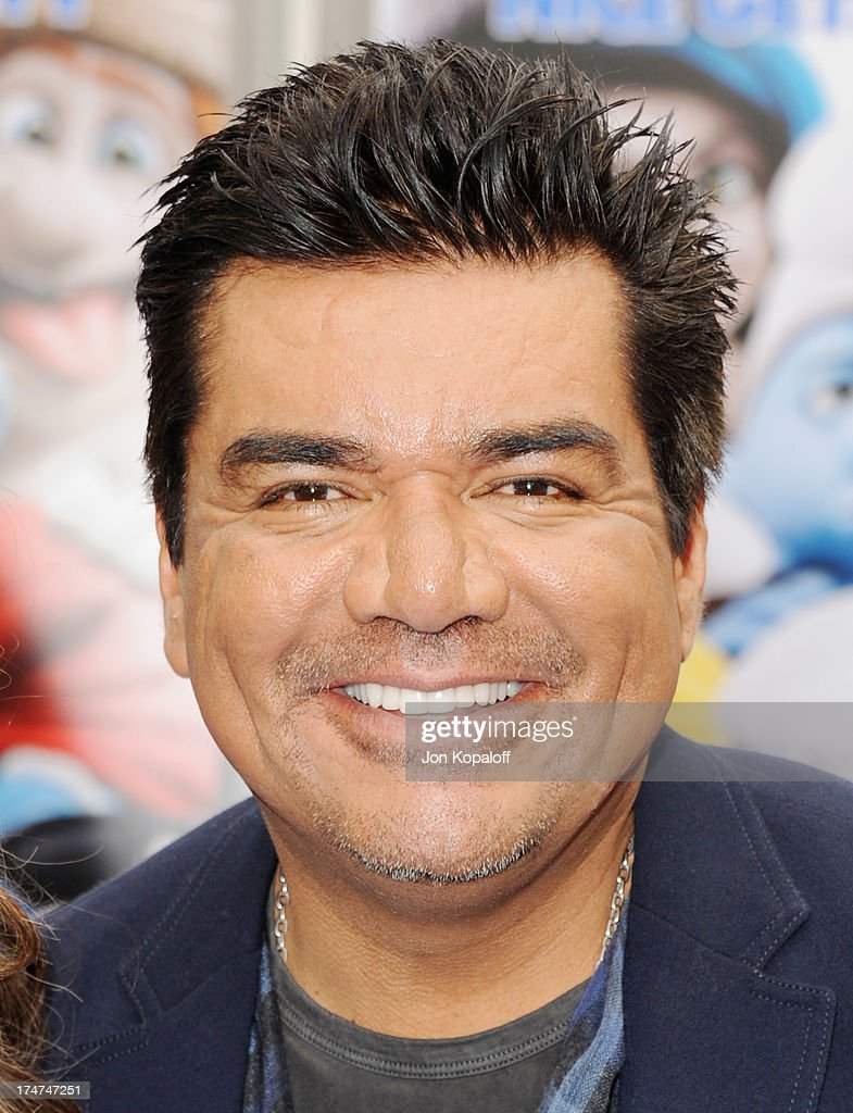 Actor George Lopez arrives at the Los Angeles Premiere 'Smurfs 2' at Regency Village Theatre on July 28, 2013 in Westwood, California.