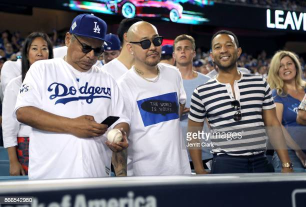 Actor George Lopez jeweler Ben Baller and musician John Legend attend The 2017 World Series Game 2 at Dodger Stadium on October 25 2017 in Los...