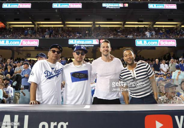 Actor George Lopez jeweler Ben Baller photographer Mike Rosenthal and musician John Legend pose for a photograph during The 2017 World Series Game 2...