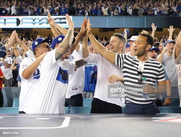 Actor George Lopez jeweler Ben Baller photographer Mike Rosenthal and musician John Legend celebrate a Dodgers homerun during The 2017 World Series...