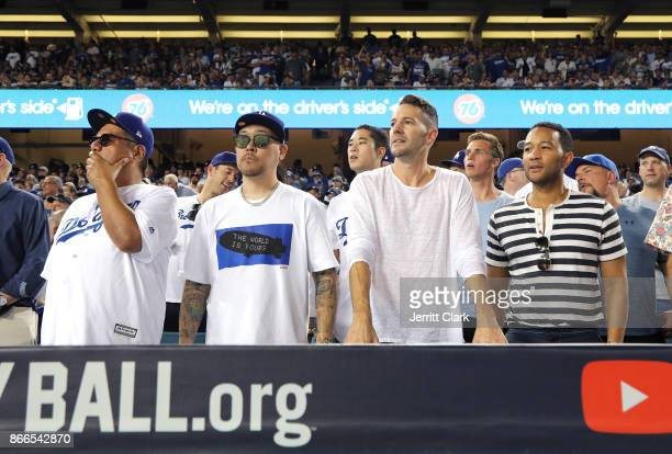 Actor George Lopez jeweler Ben Baller photographer Mike Rosenthal and musician John Legend attend The 2017 World Series Game 2 at Dodger Stadium on...