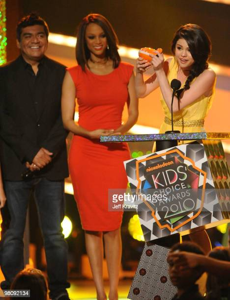 Actor George Lopez model/TV personality Tyra Banks and actress Selena Gomez speak onstage at Nickelodeon's 23rd Annual Kids' Choice Awards held at...