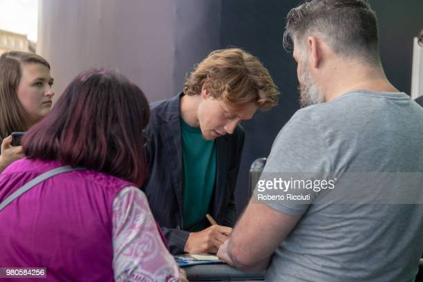 Actor George MacKay signs autographs to fans during a photocall for the UK Premiere of 'The Secret of Marrowbone' during the 72nd Edinburgh...