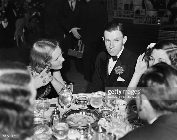 Actor George Murphy and actress Jean Arthur attend an event in Los Angeles California