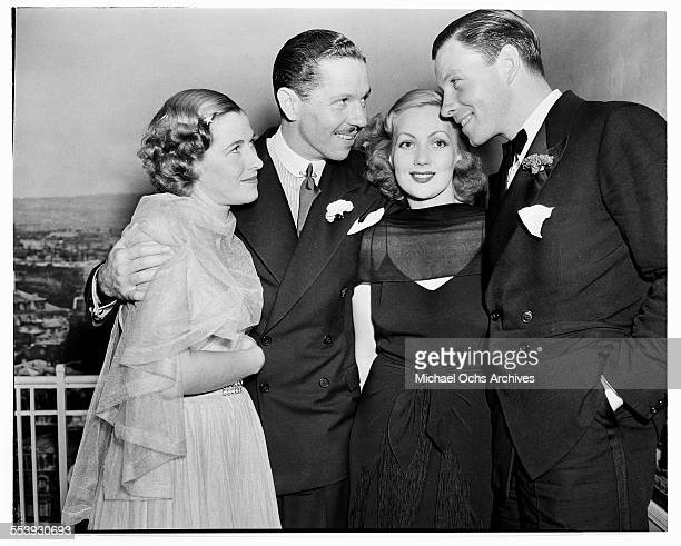 actor George Murphy and his wife Julie Johnson pose with actor Roger Pryor and his wife actress Ann Sothern during an event in Los Angeles California