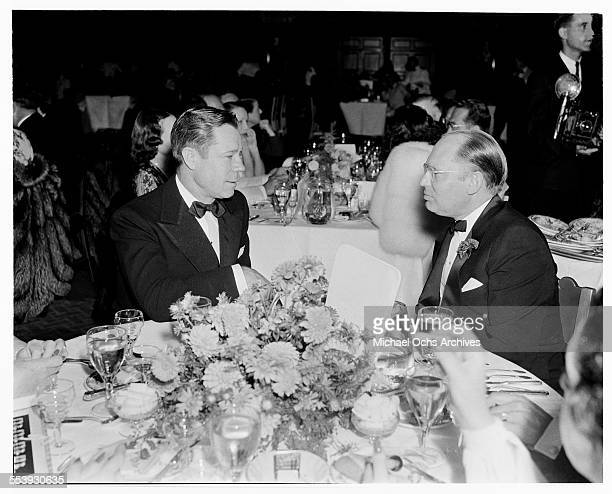 Actor George Murphy talks with Comedian Jack Benny during an event in Los Angeles California