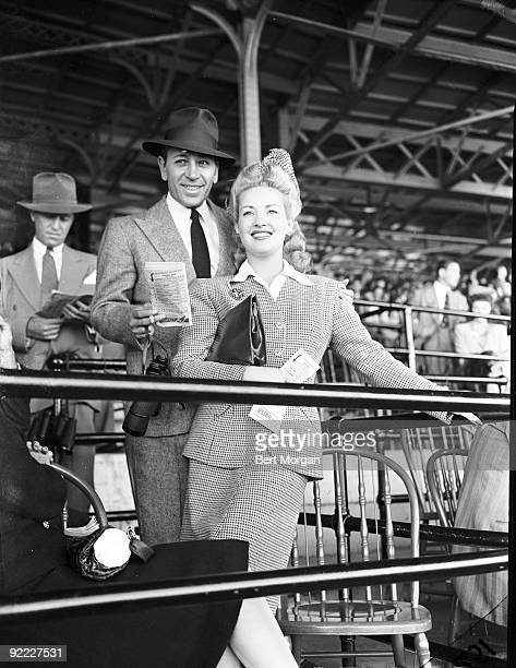 Actor George Raft and actress Betty Grable at Belmont Park Race Track Elmont NY 1939
