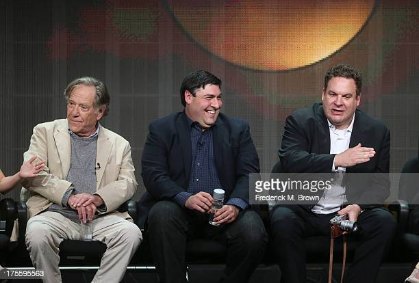 Actor George Segal writer/executive producer Adam F Goldberg and actor Jeff Garlin speak onstage during the The Goldbergs panel discussion at the...