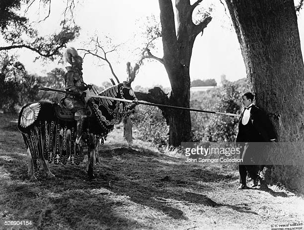 Actor George Siegmann as Sir Sagramore and actor Harry Myers as Martin Cavendish in a scene from the 1921 film A Connecticut Yankee in King Arthur's...