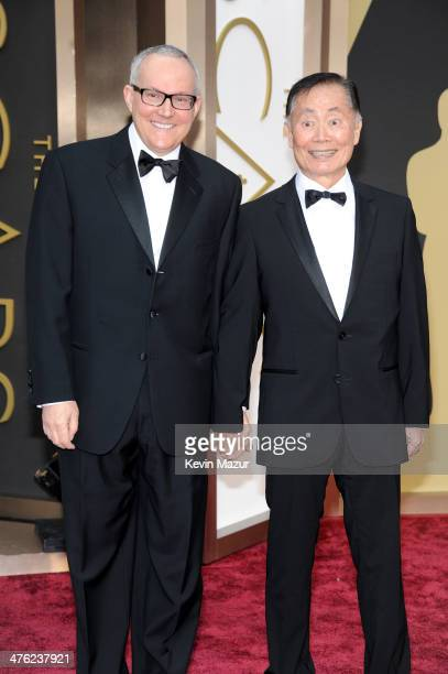 Actor George Takei and Brad Altman attend the Oscars held at Hollywood Highland Center on March 2 2014 in Hollywood California