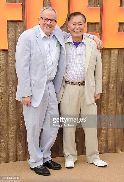 Actor George Takei and Brad Takei arrive at the Los Angeles premiere of Free Birds at Westwood Village Theatre on October 13 2013 in Westwood...
