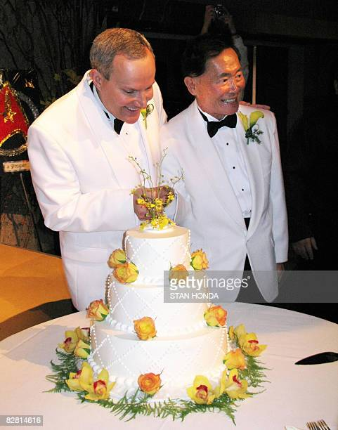 Actor George Takei and partner Brad Altman prepare to cut the cake after they were married at the Japanese American National Museum on September 14...