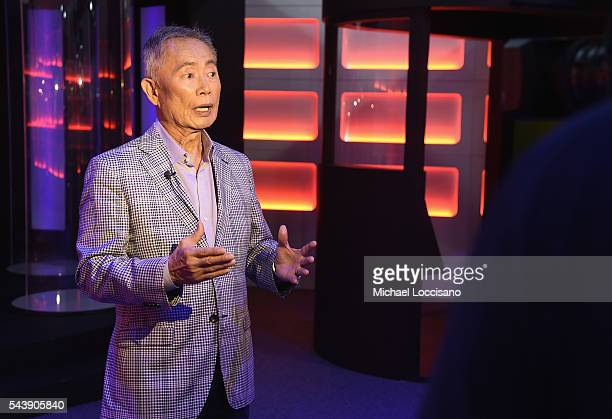 Actor George Takei is interviewed during the Star Trek The Star Fleet Academy Experience Preview at Intrepid SeaAirSpace Museum on June 30 2016 in...