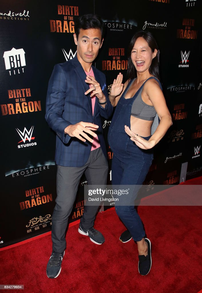 Actor George Young (L) and wife TV personality Janet Hsieh attend the premiere of WWE Studios' 'Birth of the Dragon' at ArcLight Hollywood on August 17, 2017 in Hollywood, California.