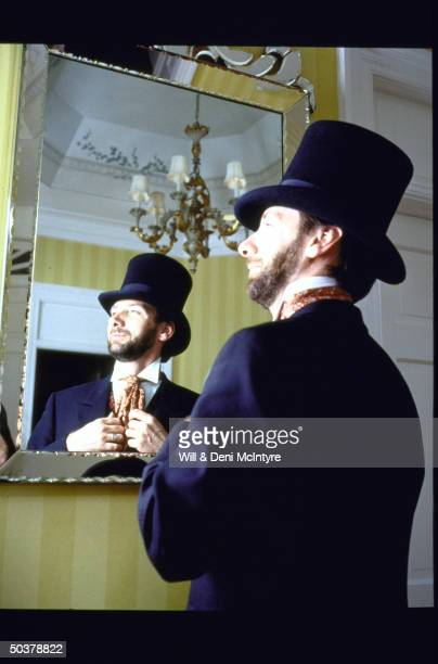 Actor Gerald Dickens greatgreatgrandson of novelist Charles Dickens standing in front of mirror in costume before playing all 26 charcacters in a one...